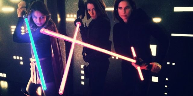 Supergirl with a lightsaber