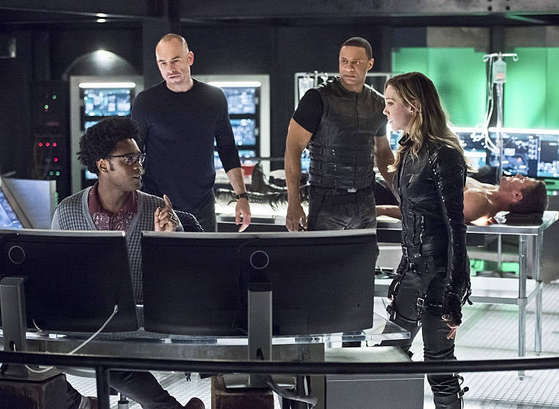 "Echo Kellum, Paul Blackthorne, David Ramsey, Stephen Amell, and Katie Cassidy as Curtis Holt, Quentin Lance, John Diggle ""Spartan,"" Oliver Queen ""Green Arrow,"" and Dinah Laurel Lance ""Black Canary."""