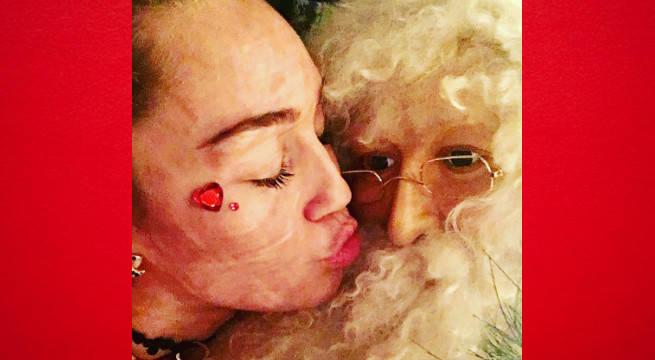Miley Kissing Santa