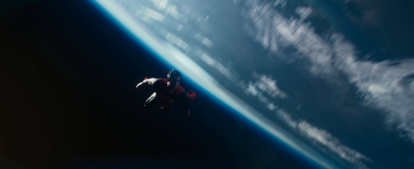 Man of steel flying in space for Flying spaces