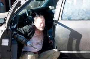 Walking Dead This Sorrowful Life Merle near car
