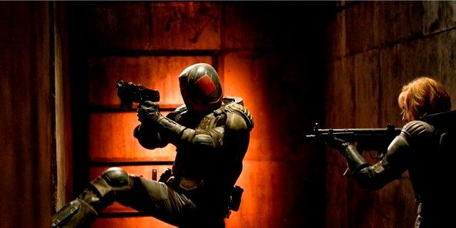 Judge Dredd (Karl Urban) and Anderson (Olivia Thirlby) in DREDD 3D.
