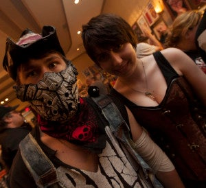 Two friends pose in costumes at Monster Mania.