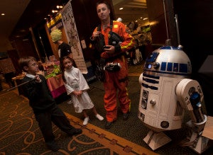 A Star Wars and Harry Potter family stands at the entrance to Monster Mania.
