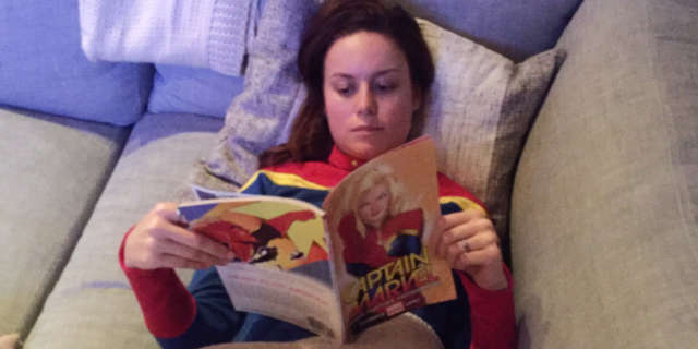 Brie Larson reading Captain Marvel Comics