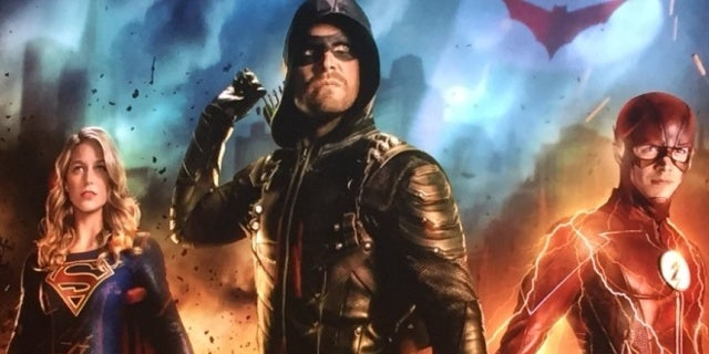 new arrowverse crossover key art teases batwomans arrival