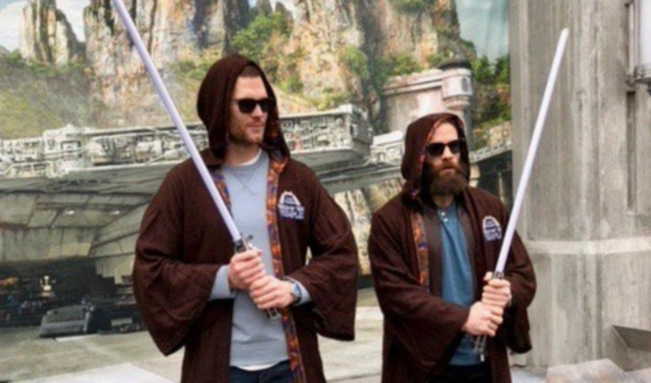 Super Bowl 2019: Tom Brady and Julian Edelman Have Lightsaber Duel at Disney World