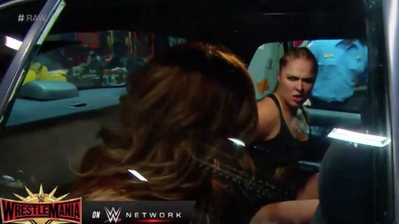 Wwe Raw Ronda Rousey Becky Lynch And Charlotte Flair Brawl Inside Cop Cars After Getting Arrested