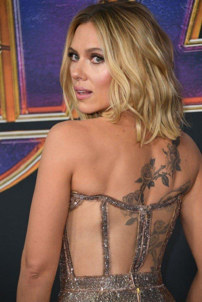 Scarlett Johansson's flaunts her new back tattoo at Avengers: Endgame Premiere.