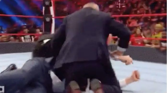 WWE-Raw-Lana-Wedding-Official-tackeled