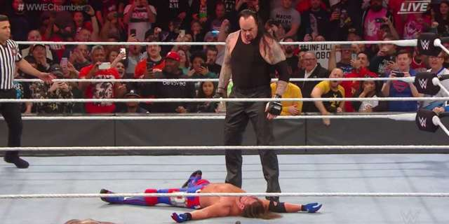 The Undertaker Arrives At Elimination Chamber To Chokeslam AJ Styles