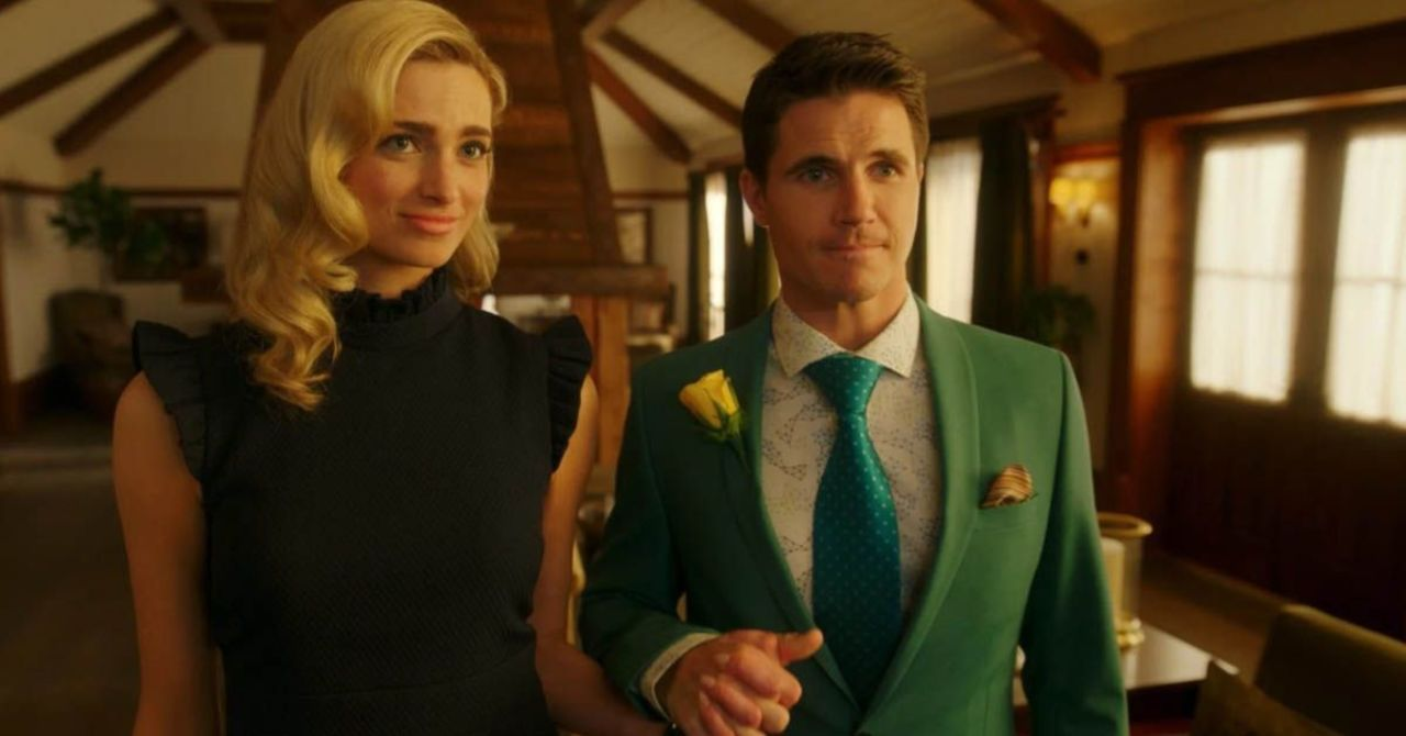 Ingrid and Nathan (Allegra Edwards and Robbie Amell) hold hands.