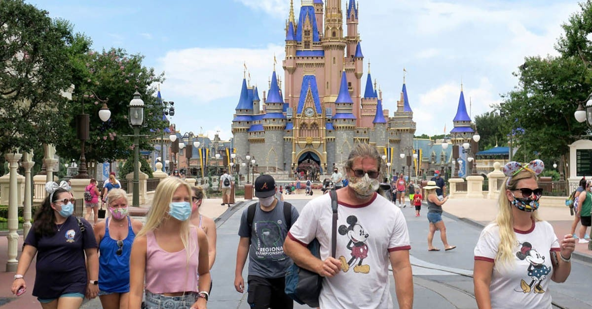 walt disney world guests wearing masks getty images