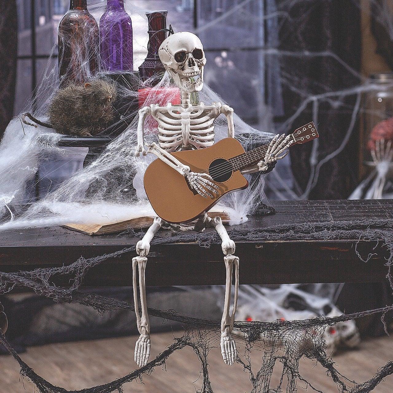guitar-playing-skeleton-halloween-decoration_13952151