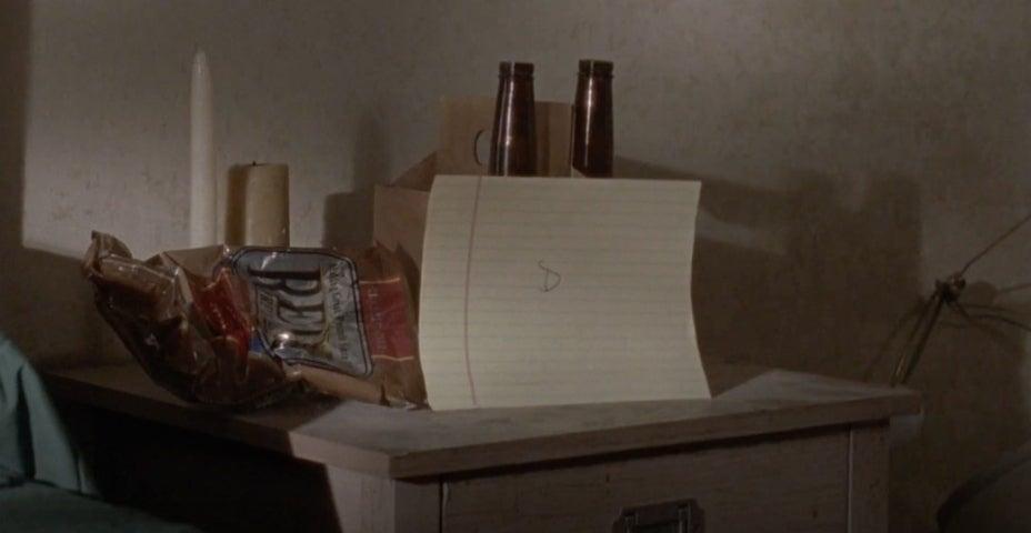 The Walking Dead Dwight Sherry letter beer pretzels ComicBook.com