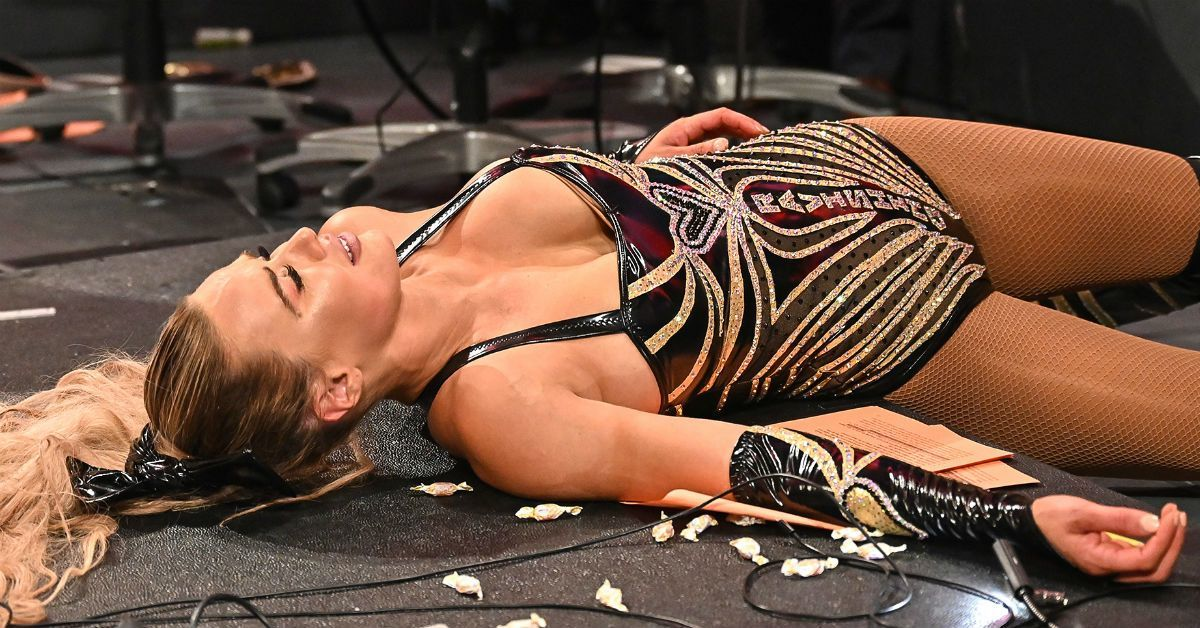 WWE-Lana-Buried-Slammed-Tables