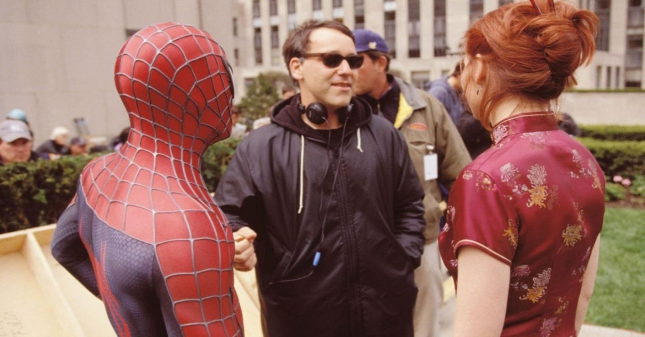 """Tobey Maguire as Spider-Man (left), director Sam Raimi (middle), and Kirsten Dunst as Mary Jane Watson (right) in """"Spider-Man"""" (2002)"""