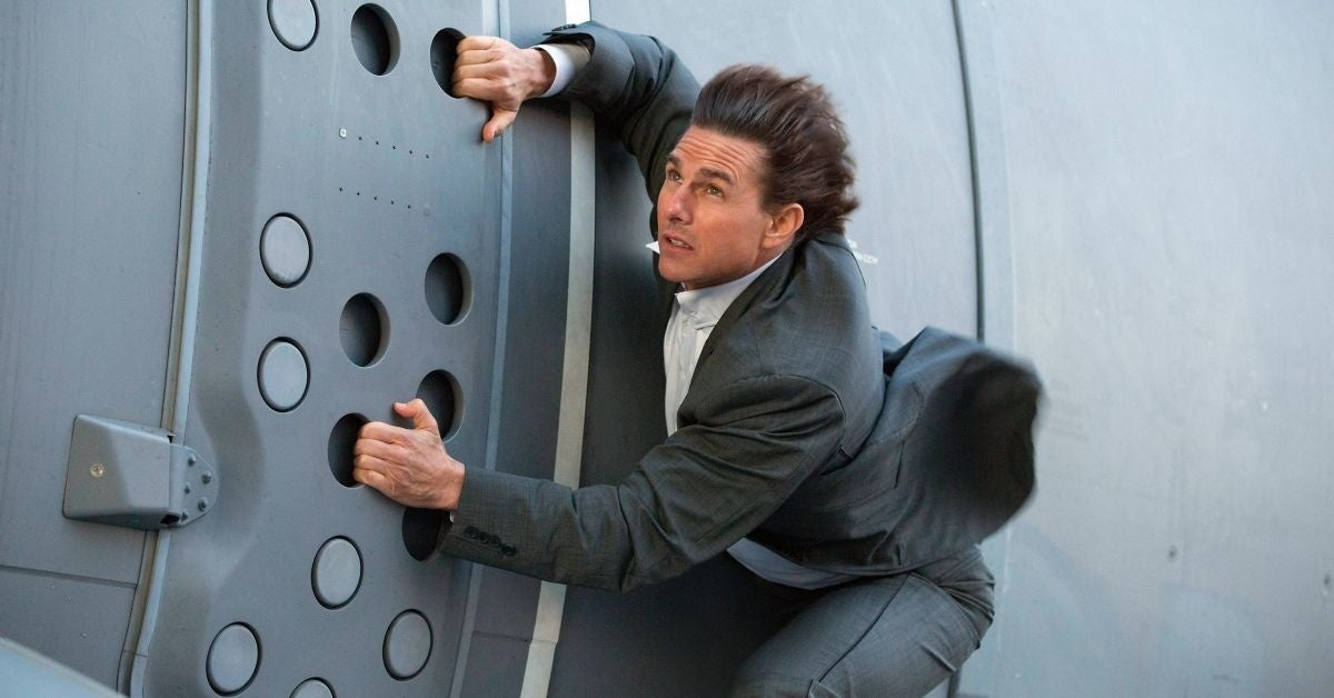 mission impossible director tom cruise hanging train stunt