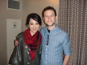 Summer Qing with her co-star, Joseph Gordon-Levitt, on the set of LOOPER.