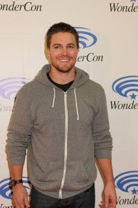 From hood to hoodie! ARROW star Stephen Amell looks sharp at WonderCon in Anaheim on Sunday, March 31. ARROW airs Wednesdays at 8/7c on The CW. (©2013 Warner Bros. Entertainment, Inc. All Rights Reserved.)