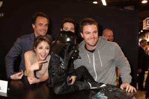 The force is with this young costumed fan, dressed as Darth Vader, who found himself up close and personable with ARROW stars (left to right) Paul Blackthorne, Willa Holland, Colin Donnell and Stephen Amell at the DC Entertainment booth on Sunday, March 31. ARROW airs Wednesdays at 8/7c on The CW.. (©2013 Warner Bros. Entertainment, Inc. All Rights Reserved.)