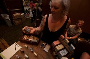 "Jenna from Ivyland, Pa., shows off a soap called ""Swallow Your Soul."" Each of her soaps is named after a horror film. Swallow Your Soul is cinnamon-scented and sells for $5.50 on her website, https://www.arcanebunnysociety.com"