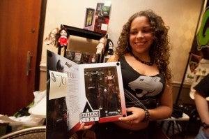 Marissa from Mantua, N.J. shows off an Arkham City Harley Quinn doll.