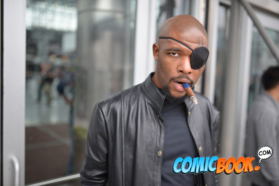 Nick Fury (from the Ultimates and/or the Marvel Cinematic Universe) or Nick Fury, Jr. (from the Marvel Universe)